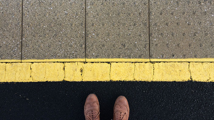 Behind-yellow-line-blog-700x394